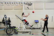 Clinical Exercise Specialist Emma Dawson, righ, tosses a medicine ball to Riley Ljungdahl, 12, of Longmont, during physical therapy, Tuesday, April 30, 2013, at the Peak Center at Craig Hospital.<br /> (Matthew Jonas/Times-Call)