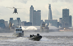 © Licensed to London News Pictures. 19/01/2012. London, UK. Officers from Scotland Yard and Royal Marines take part in a rehearsal exercise for Olympics security on the River Thames at Woolwich Arsenal Pier, London on January 19, 2012. Photo credit : Ben Cawthra/LNP