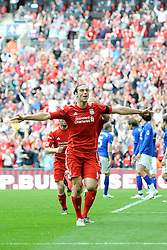 Andy Carroll of Liverpool celebrates scoring the winning goal during the Budweiser FA Cup semi final match between Liverpool and Everton at Wembley on Saturday 14 April 2012 (Photo by Rob Munro)