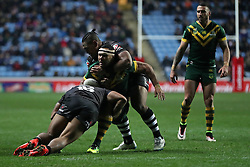 Australia's Justin O'Neill is tackled by New Zealand's Manu Ma'u and Solomone Kata (back) during the Four Nations match at the Ricoh Arena, Coventry.