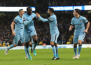 Yaya Toure of Manchester City celebrates with Gael Clichy after scoring the first goal against Sunderland during the Barclays Premier League match at the Etihad Stadium, Manchester.<br /> Picture by Michael Sedgwick/Focus Images Ltd +44 7900 363072<br /> 01/01/2015