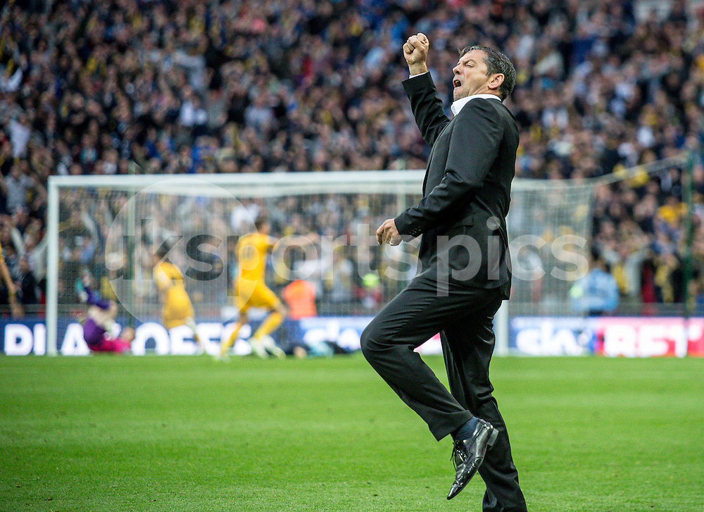 Southend United Manager Phil Brown celebrates his sides equaliser during the Sky Bet League 2 Play-Off Final match between Southend United and Wycombe Wanderers at Wembley Stadium, London, England on 23 May 2015. Photo by Liam McAvoy.