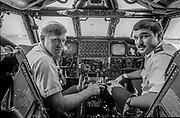 Castle Air Force Base-July 30, 1980- Emmett Corrigan and I went to CAFB to interview pilots and crew of the B-52 that we younger than the aircraft that they were flying.<br /> Instructor pilot Capt. Bruce Van Wagner and Student Pilot 2nd Lt. Keith Pearson.<br /> <br /> Castle is named for Brigadier General Frederick W. Castle, who died on Dec. 24, 1944 flying his 30th bombing mission. He died leading an armada of 2000 B-17s on a strike against German airfields. On the way to the target, an engine failure over Liege, Belgium caused his bomber to fall behind, where it was attacked by Germans and caught fire. He ordered his men to bail out but stayed alone at the controls of the flaming Flying Fortress until it crashed. The entire crew, except Gen. Castle and one airman killed before the bailout order, survived. Gen. Castle received a Medal of Honor posthumously for his bravery.<br /> <br /> Castle became home to the 93rd Bombardment Wing in 1947. Aircraft stationed at Castle included B-29, B-17 and C-54 aircraft, with B-50 bombers arriving in 1949. In 1954, B-47 bombers arrived.  On June 29, 1955, Castle received the Air Force's first B-52. These heavy bombers can hold the equivalent of three railroad cars' worth of fuel. The first Air Force KC-135 jet tanker arrived May 18, 1957<br /> <br /> Castle was selected for closure under the Defense Base Closure and Realignment Act of 1990 during Round II Base Closure Commission deliberations (BRAC 91). The last of the B-52s left the base in 1994, followed by the departure of the last of the KC-135s in early 1995. The base closed September 30, 1995.