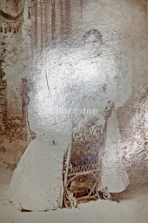 emulsion light reflected photo with studio portrait of two adult woman