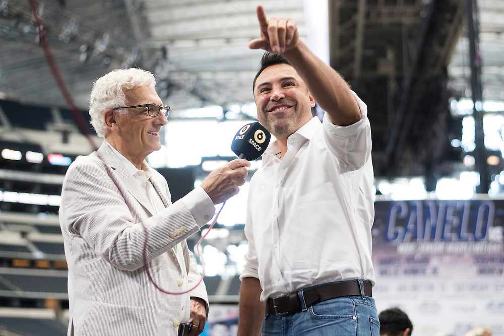 Oscar De La Hoya waves towards fans as he visits with the media at AT&T Stadium in Arlington, Texas before the weigh-ins on September 16, 2016.  (Cooper Neill for ESPN)