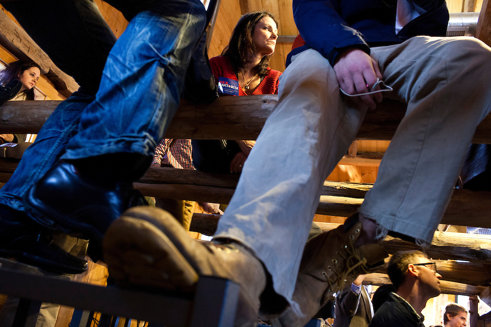 Felita Carr, top center, of Hollis, New Hampshire, listens as Republican presidential candidate Rick Santorum hosts a town hall meeting at Lawrence Barn on Saturday, January 7, 2012 in Hollis, NH. Brendan Hoffman for the New York Times