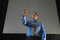 Business man speaking at conference, pointing