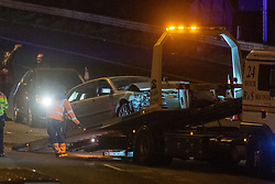 © Licensed to London News Pictures. 01/04/2020. Gerrards Cross, UK. A damaged car is moved on to a tow truck on the southbound carriageway of the M40 motorway between J2 and J1a. The M40 motorway was closed in both directions due to a Road Traffic collision involving a heavy goods vehicle and at least to cars. Photo credit: Peter Manning/LNP