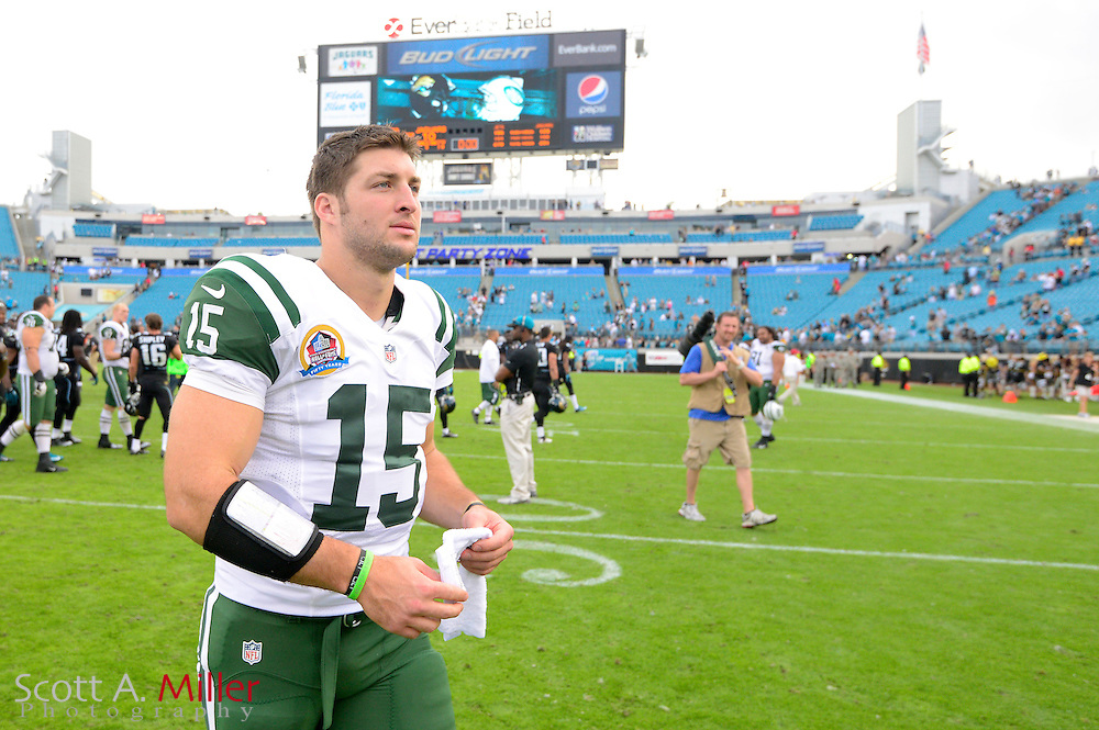 New York Jets quarterback Tim Tebow (15) walks off the field after an NFL game against the Jacksonville Jaguars at EverBank Field on Dec 9, 2012 in Jacksonville, Florida. The Jets won 17-10...©2012 Scott A. Miller..
