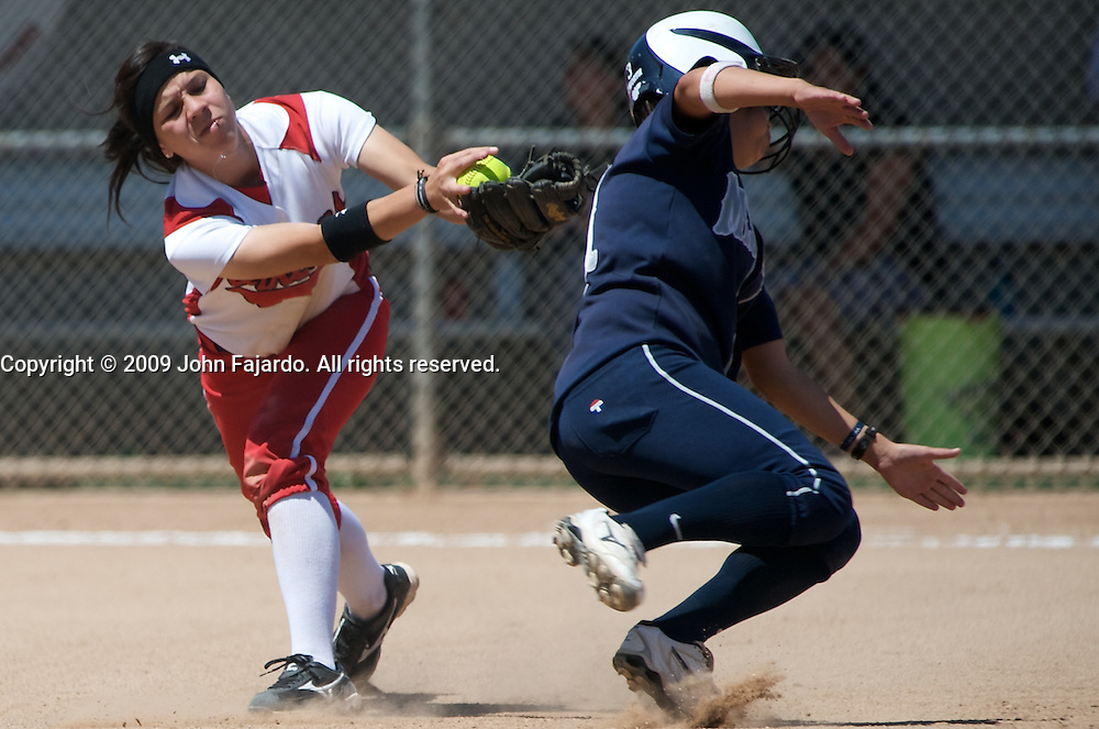 LBCC infielder Rose Vargas misses the tag on baserunner Amanda Gutierrez in game three of the first round Southern California Regional Playoff against Los Angeles Mission College at the LAC Softball field on Sunday May 3, 2009.  The Vikings forced game three after defeating L.A. Mission 6-0 earlier in the day.