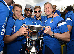 Bristol Rovers' Lee Brown, Ellis Harrison, Matt Taylor and Lee Mansell celebrate with the Vanarama Conference Play-Off Final trophy - Photo mandatory by-line: Dougie Allward/JMP - Mobile: 07966 386802 - 25/05/2015 - SPORT - Football - Bristol - Bristol Rovers Bus Tour