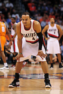 Mar. 21 2010; Phoenix, AZ, USA; Portland Trailblazers guard Jerryd Bayless (4) reacts during in the first half at the US Airways Center.   Mandatory Credit: Jennifer Stewart-US PRESSWIRE.