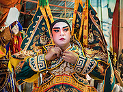 15 OCTOBER 2015 - BANGKOK, THAILAND:  A Chinese opera performer waits to go on stage at the Vegetarian Festival at the Joe Sue Kung Shrine in the Talat Noi neighborhood of Bangkok. The Vegetarian Festival is celebrated throughout Thailand. It is the Thai version of the The Nine Emperor Gods Festival, a nine-day Taoist celebration beginning on the eve of 9th lunar month of the Chinese calendar. During a period of nine days, those who are participating in the festival dress all in white and abstain from eating meat, poultry, seafood, and dairy products. Vendors and proprietors of restaurants indicate that vegetarian food is for sale by putting a yellow flag out with Thai characters for meatless written on it in red. The shrine is famous for the Chinese opera it hosts during the Vegetarian Festival. The operas are free.   PHOTO BY JACK KURTZ