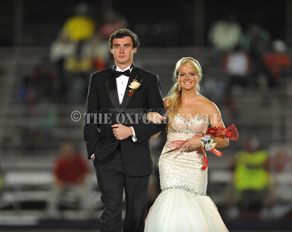 Senior maid Madeline Ball is escorted by Brent Carson during Homecoming at Lafayette High vs. Shannon in Oxford, Miss. on Friday, September 19, 2014. Lafayette High won 35-0 to improve to 2-3 on the season.