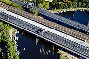 Nederland, Noord-Holland, Amsterdam, 27-09-2015; roeiers op de Amstel te hoogte van de Rozenoordbrug, een complex van drie bruggen voor spoor, metro en autoverkeer (Ring A10). <br /> Rowers on the river Amstel near the Rozenoord Bridge, a complex of three bridges for rail, metro and traffic.<br /> <br /> luchtfoto (toeslag op standard tarieven);<br /> aerial photo (additional fee required);<br /> copyright foto/photo Siebe Swart
