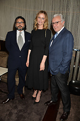 Left to right, HANI FARSI, EVA HERZIGOVA and ALAIN DUCASSE at the Launch Of Alain Ducasse's Rivea Restaurant At The Bulgari Hotel, 171 Knightsbridge, London on 8th May 2014.