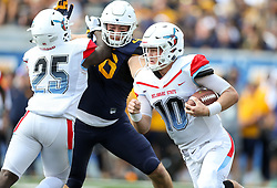 Sep 16, 2017; Morgantown, WV, USA; Delaware State Hornets quarterback Jack McDaniels (10) runs the ball during the first quarter against the West Virginia Mountaineers at Milan Puskar Stadium. Mandatory Credit: Ben Queen-USA TODAY Sports