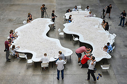 "© Licensed to London News Pictures. 26/07/2019. LONDON, UK.  Preview of ""The cubic structural evolution project"", 2004, by Olafur Eliasson at Tate Modern.  Exhibited for the first time in the UK, the artwork comprises one tonne of white Lego bricks inspiring visitors to create their own architectural vision for a future city and is on display until 18 August 2019.  The work coincides with the artist's new retrospective exhibition ""In real life"" at Tate Modern on display to 5 January 2020.  Photo credit: Stephen Chung/LNP"