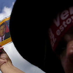 A supporter of Venezuelan President Hugo Chavez holds a picture of the embattled President, Dec. 20, 2002, outside the Venezuelan Senate building in dowetown Caracas. The  country is in the midst of a crippling 18 day strike that has pitted supporters and opponents of Chavez against each other.
