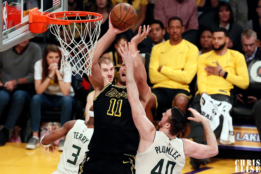 30 March 2018: Los Angeles Lakers center Brook Lopez (11) goes for the jump shot  over Milwaukee Bucks center Marshall Plumlee (40) during the Milwaukee Bucks 124-122 victory over the LA Lakers, at the Staples Center, Los Angeles, California, USA.