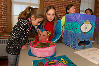 4th grade students from Pleasant Street School Ava Smith and Kaia Lescarbeau turn on the lights in  their Ocean Life project while Amaya Dutile presents her Asian potato named FU during Makers Night at the Belknap Mill on Thursday evening.   (Karen Bobotas/for the Laconia Daily Sun)