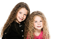 two caucasian little girls complicity portrait isolated studio on white background