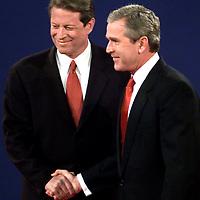 Debate handshake at UMASS Boston Oct3, 2000.  Al Gore and George Bush. Photo: Mark Garfinkel