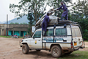One of the outreach clinic vehicles being loaded from the Bwindi Community Hospital.  As part of the outreach programme they cover 32 primary schools and 5 secondary schools in the region as well as many communities. The main Bwindi Community Hospital is in Buhoma village on the edge of the Bwindi Impenetrable Forest in Western Uganda. It serves around 250,000 people from the surrounding area.