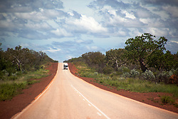A truck travels down the main highway from Fitzroy Crossing up to Derby in the wet season.