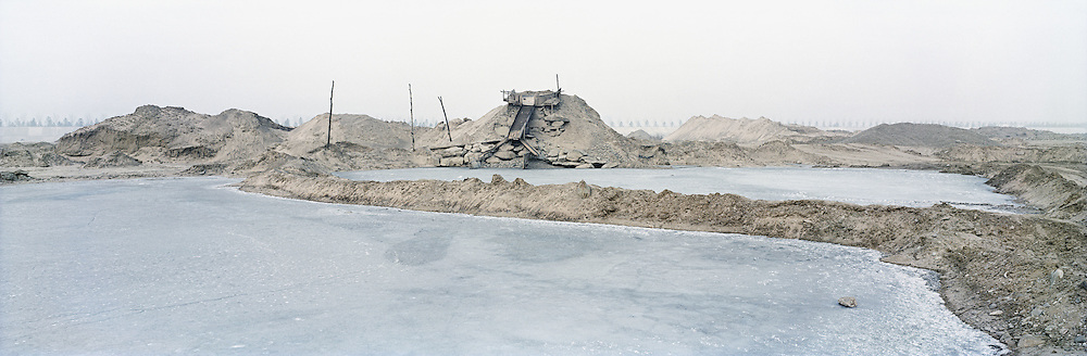 A make shift screening machinery that is built at the bottom of a river bed that is now nearly dry due to overmining in the area. Industrious entrepreneurs have exploited this misfortune by digging up the rocks in the area and selling it for construction. Yulin, Shaanxi, China. 2010