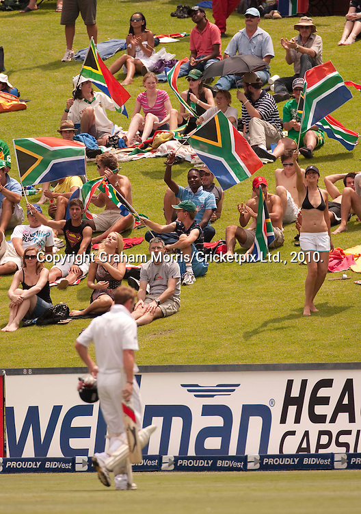 Paul Collingwood walks off past South African flags during the fourth and final Test Match between South Africa and England at the Wanderers Stadium, Johannesburg. Photograph © Graham Morris/cricketpix.com (Tel: +44 (0)20 8969 4192; Email: sales@cricketpix.com)