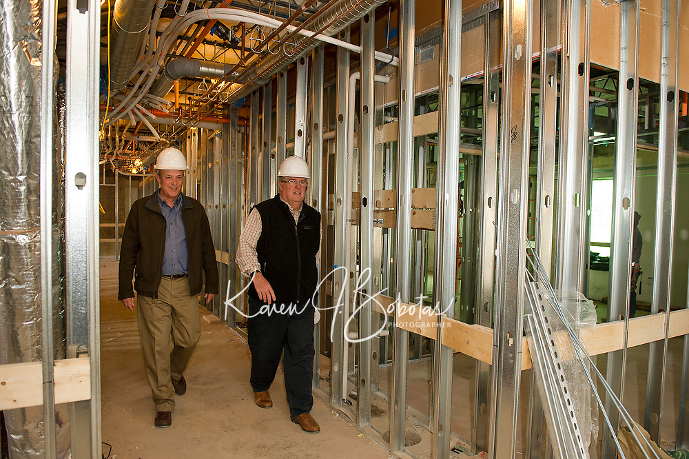 Dick Weaver and Tom Cochran of Laconia Housing on a walk-through of the 3rd floor of the Sunrise House building project on Wednesday morning.  (Karen Bobotas/for the Laconia Daily Sun)