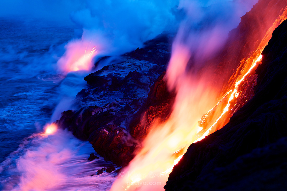 Several lava flows from active volcano Kilauea enter the ocean at the Kalapana lava field on the Big Island of Hawaii.