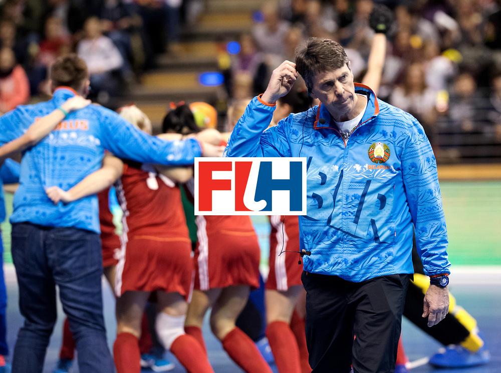 BERLIN - Indoor Hockey World Cup<br /> Bronze: Ukraine - Belarus<br /> Belarus wins 3rd place.<br /> foto: Herman Kruis walks away from his celebrating team.<br /> WORLDSPORTPICS COPYRIGHT FRANK UIJLENBROEK