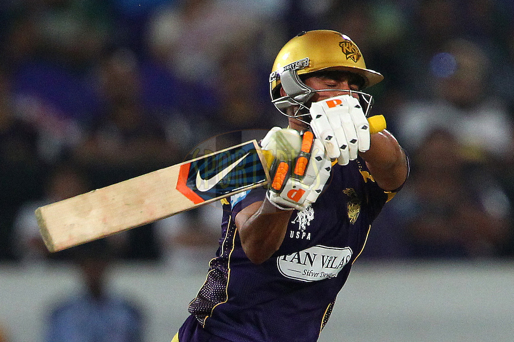 /Manish PANDEY of the Kolkata Knight Riders plays a rising delivery from Ben LAUGHLIN of the Hobart Hurricanes  during the first semi final match of the Oppo Champions League Twenty20 between the Kolkata Knight Riders and the Hobart Hurricanes held at the Rajiv Gandhi Cricket Stadium, Hyderabad, India on the 2nd October 2014<br /> <br /> Photo by:  Ron Gaunt / Sportzpics/ CLT20<br /> <br /> <br /> Image use is subject to the terms and conditions as laid out by the BCCI/ CLT20.  The terms and conditions can be downloaded here:<br /> <br /> http://sportzpics.photoshelter.com/gallery/CLT20-Image-Terms-and-Conditions-2014/G0000IfNJn535VPU/C0000QhhKadWcjYs