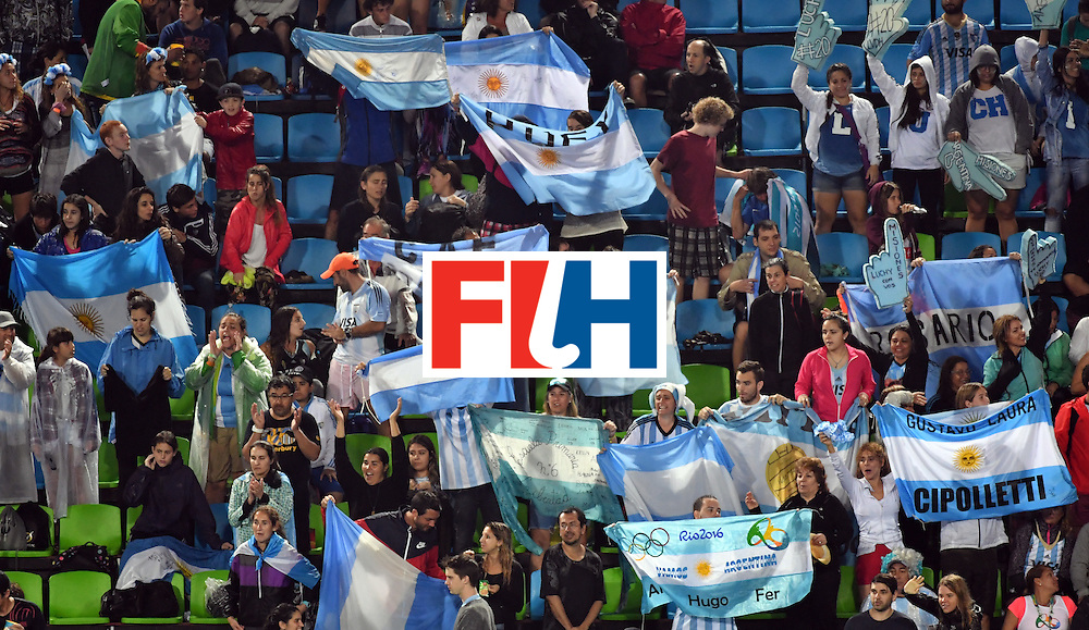 Argentina fans cheer their team during the women's quarterfinal field hockey Netherlands vs Argentina match of the Rio 2016 Olympics Games at the Olympic Hockey Centre in Rio de Janeiro on August 15, 2016.  / AFP / Pascal GUYOT        (Photo credit should read PASCAL GUYOT/AFP/Getty Images)