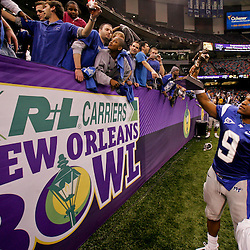 Dec 20, 2009; New Orleans, LA, USA; Middle Tennessee State Blue Raiders quarterback Dwight Dasher (9) holds up the MVP trophy for fans following the 2009 New Orleans Bowl at the Louisiana Superdome. Middle Tennessee State defeated Southern Miss 42-32. Mandatory Credit: Derick E. Hingle-US PRESSWIRE