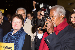 "London, October 23 2017. Nelson Mandela's group of Elders including former UN Secretary General Kofi Annan and Secretary General Ban Ki-moon accompanied by his widow Graca Machel gather at Parliament Square at the start of the Walk Together event in memory of Nelson Mandela before a candlelight vigil at his statue in Parliament Square. ""WalkTogether is a global campaign to inspire hope and compassion, celebrating communities working for the freedoms that unite us"". PICTURED: A mischievous Kofi Annan borrows a press photographer's camera. © Paul Davey"
