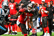 Tampa Bay Buccaneers Wide Receiver Mike Evans (13) fumbles during the International Series match between Tampa Bay Buccaneers and Carolina Panthers at Tottenham Hotspur Stadium, London, United Kingdom on 13 October 2019.