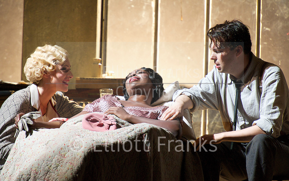 La Boheme<br /> by Giacomo Puccini <br /> translation by Amanda Holden <br /> conductor Gianluca Marciano<br /> directed by Jonathan Miller<br /> revival director Natascha Metherell<br /> <br /> at the London Coliseum, London, Great Britain <br /> rehearsal <br /> 27th October 2014 <br /> <br /> <br /> Jennifer Holloway as Musetta<br /> <br /> Angel Blue as Mimi <br /> <br /> David Butt Philip as Rodolfo <br /> <br /> <br /> Photograph by Elliott Franks