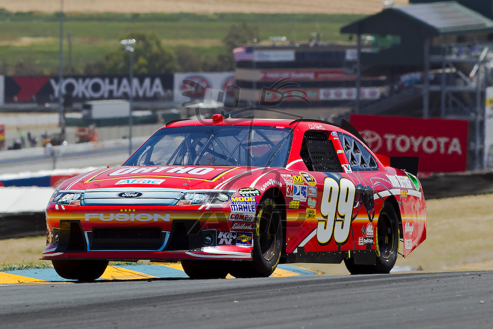 Sonoma, CA - June 24, 2011:  Carl Edwards (99) brings his race car through the turns during a practice session for the Toyota/Save Mart 350 race at the Infineon Raceway in Sonoma, CA.