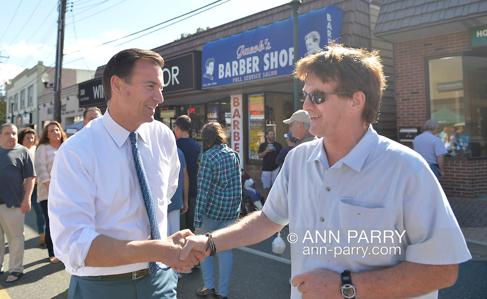 Bellmore, New York, U.S. 22nd September 2013. Former Nassau County Executive TOM SUOZZI (Democrat), who is running for his former office again, makes a campaign visit at the 27th Annual Bellmore Festival, featuring family fun with exhibits and attractions in a 25 square block area, with over 120,000 people expected to attend over the weekend.