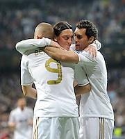 FUSSBALL   CHAMPIONS LEAGUE   SAISON 2011/2012  Achtelfinale Rueckspiel 14.03.2012 Real Madrid  - ZSKA Moskau  JUBELKREIS Real Madrid; Mesut Oezil (Mitte) umarmt Karim Benzema (li) und Alvaro Arbeloa