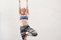 Heather Meyers yoga in the soft lit Hardlight Studio