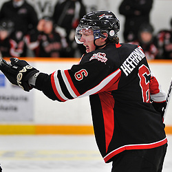 TRENTON, ON - Jan 5 : Ontario Junior Hockey League game between Stouffville Spirit and Trenton Golden Hawks. Matthew Heffernan #6 of the Stouffville Spirit discusses a check on a teammate with an OHA Linesman..(Photo by Shawn Muir / OJHL Images)