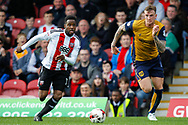 Florian Jozefzoon of Brentford and Aden Flint of Bristol City during the Sky Bet Championship match between Brentford and Bristol City at Griffin Park, London<br /> Picture by Mark D Fuller/Focus Images Ltd +44 7774 216216<br /> 01/04/2017
