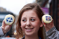 Hannah Vigers who works in the Cuckoo's bakery looking to her scottish cupcake.<br /> Cupcakes referendum photocall to take place. Cuckoo's bakery has been selling Yes, No and undecided cupcakes since March .<br /> Pako Mera/Universal News And Sport (Europe) 17/09/2014