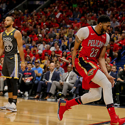May 4, 2018; New Orleans, LA, USA; New Orleans Pelicans forward Anthony Davis (23) reacts after a dunk as Golden State Warriors guard Stephen Curry (30) looks on during the fourth quarter in game three of the second round of the 2018 NBA Playoffs at Smoothie King Center. The Pelicans defeated the Warriors 119-100. Mandatory Credit: Derick E. Hingle-USA TODAY Sports