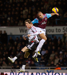 LONDON, ENGLAND - Wednesday, January 30, 2008: Liverpool's Fernando Torres and West Ham United's Anton Ferdinand during the Premiership match at Upton Park. (Photo by David Rawcliffe/Propaganda)