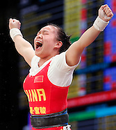 Nov 21, 2015; Houston, TX, USA; Huihua Jiang, from China, reacts after winning in the women's 48kg division at the International Weightlifting Federation World Championships at George R. Brown Convention Center. Mandatory Credit: Thomas B. Shea-USA TODAY Sports